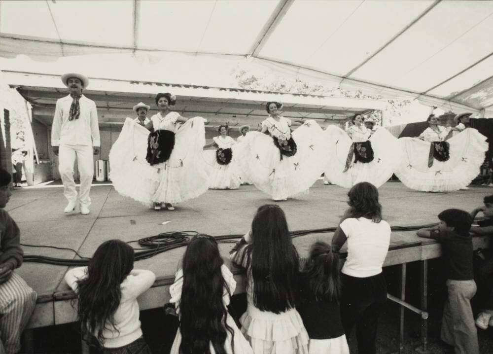A folklorico dance troupe performs on stage at the Sonoma County Fair Mexican Village with group of youngsters watching. (Courtesy of the Sonoma County Library)