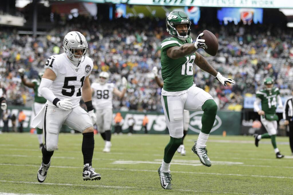 New York Jets wide receiver Demaryius Thomas, right, runs away from Oakland Raiders inside linebacker Will Compton during the first half, Sunday, Nov. 24, 2019, in East Rutherford, N.J. (AP Photo/Adam Hunger)