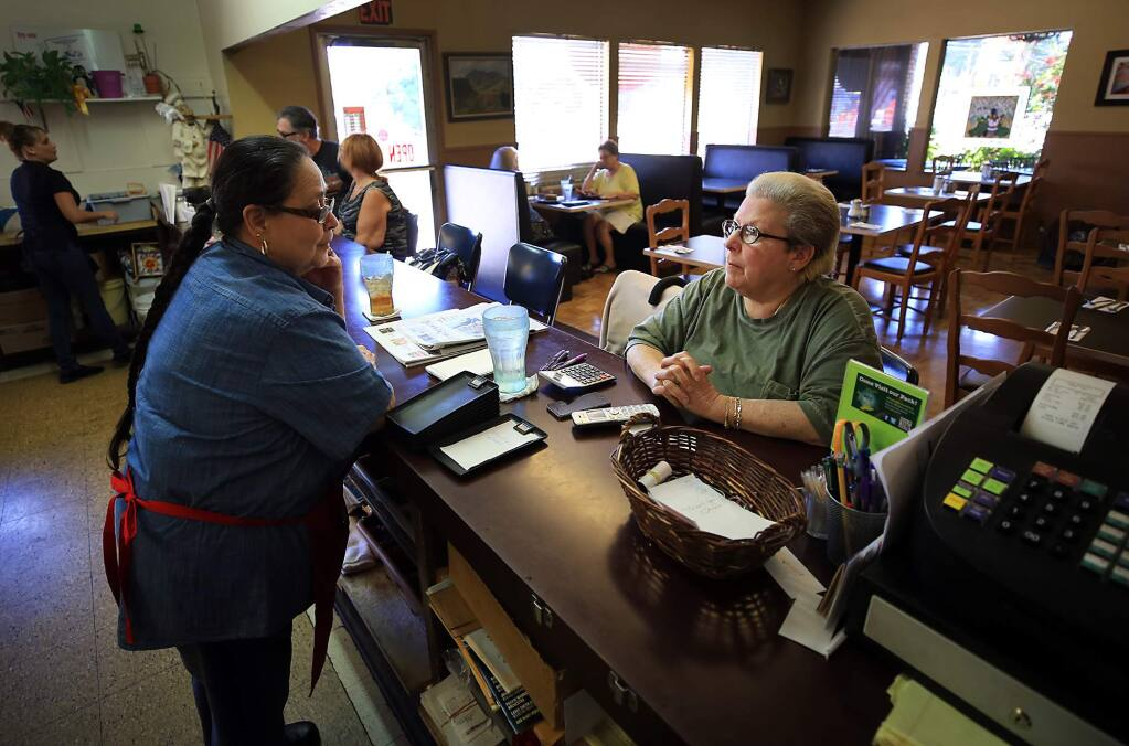Singletree Cafe co-owners Nanci Van Praag, right, and Dolores Rodriguez wait for customers, on Monday June 26, 2017. (Kent Porter / Press Democrat) 2017