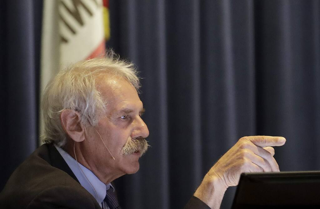 FILE - In this Jan. 28, 2019, file photo, Michael Picker, President of the California Public Utilities Commission, speaks during a meeting in San Francisco. The head of California's Public Utilities Commission has announced he will retire after almost five years on a job dominated by oversight of devastating wildfires. (AP Photo/Jeff Chiu, File)