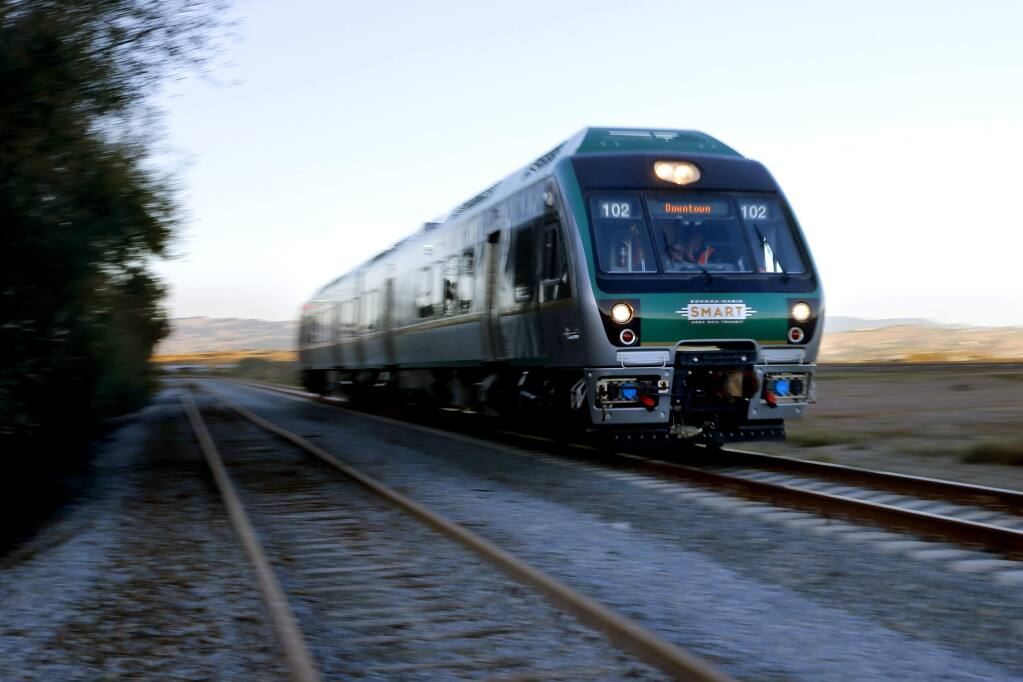 The SMART train moves along at 79 miles per hour during testing along a section of track through 'The Narrows' in Novato, on Tuesday, November 3, 2015. (BETH SCHLANKER/ The Press Democrat)