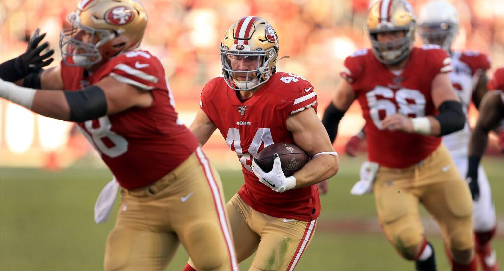 Kyle Juszczyk rips for a first down during San Francisco's 36-26 win over Arizona, Sunday, Nov. 17, 2019 in Santa Clara. (Kent Porter / The Press Democrat) 2019