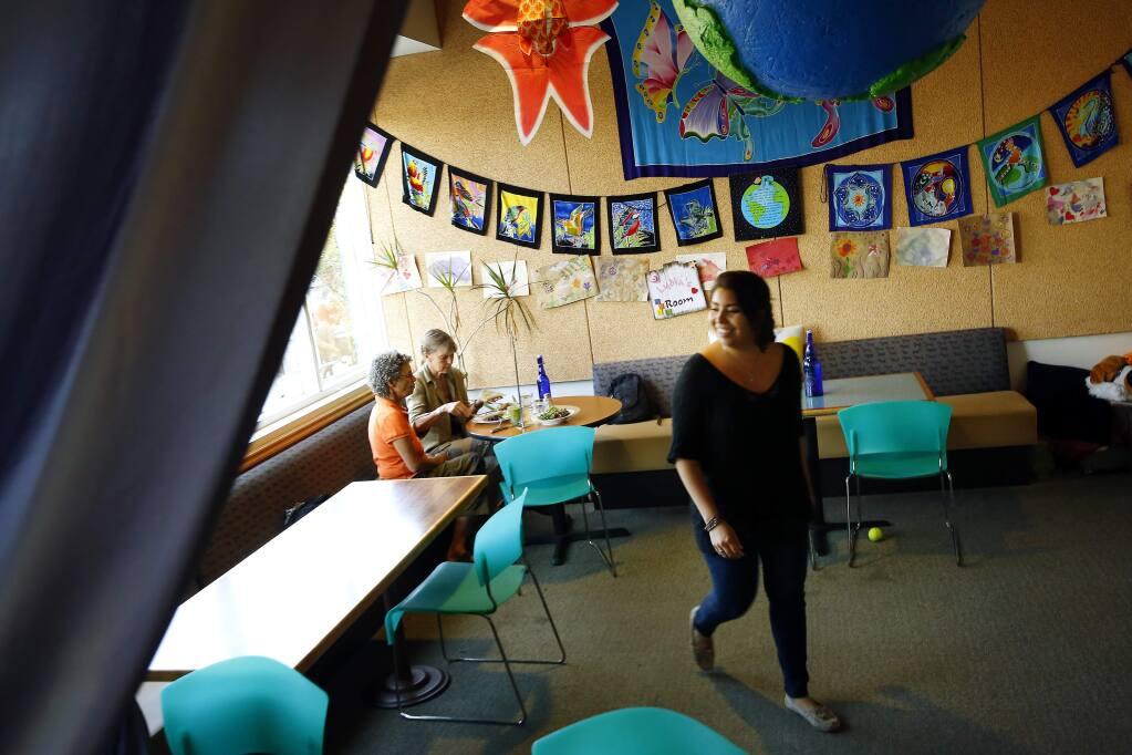 Bianca Nunez, right, serves patrons at Sunflower Restaurant and Lydia's Organics in Petaluma on Wednesday, Sept. 3, 2014. (Conner Jay/The Press Democrat)