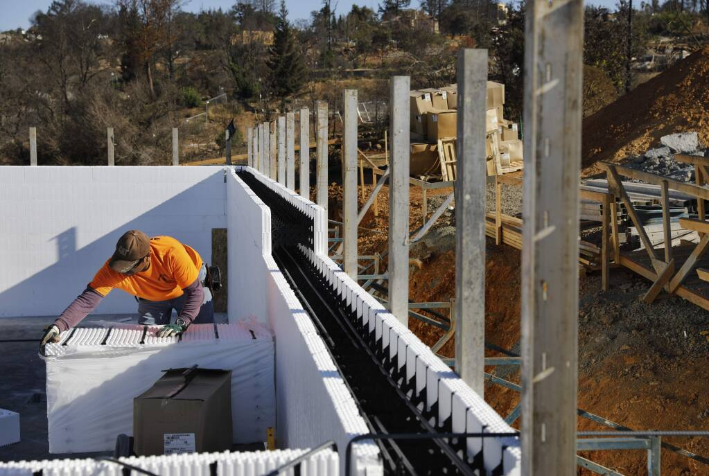 Felix Aguilar installs forms made of polystyrene foam as part of the IntegraSpec building system. The forms will be filled with rebar and concrete. Photo taken in the Fountaingrove area of Santa Rosa on Thursday, September 20, 2018. (Beth Schlanker/ The Press Democrat)