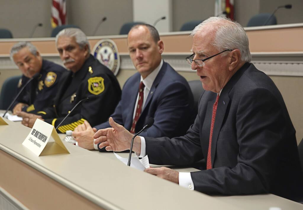 Rep. Mike Thompson, D-St. Helena, right, leads a discussion on gun violence during a hearing in Sacramento, Calif., Monday, Dec. 14, 2015. Thompson, chairman of the House Democrats' Gun Violence Prevention Task Force, and a panel including law enforcement, a Arizona gun show dealer, a California gun club owner, a former gang member and other gun control advocates discussed closing loopholes in federal background checks and providing more help for the mentally ill.(AP Photo/Rich Pedroncelli)