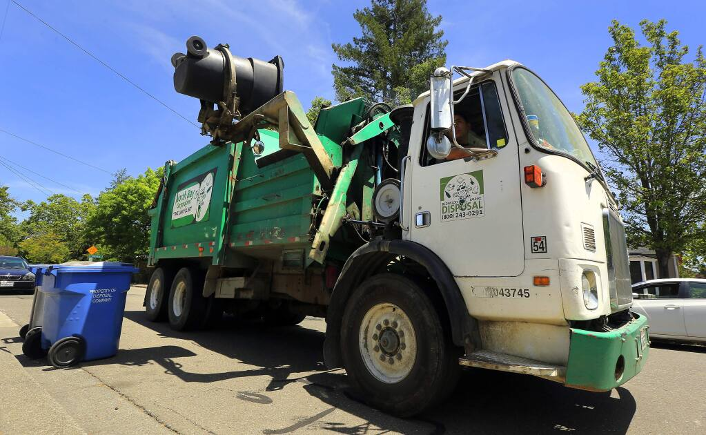 (File photo) A North Bay Corporation truck picks up green waste in Santa Rosa . (JOHN BURGESS/The Press Democrat)