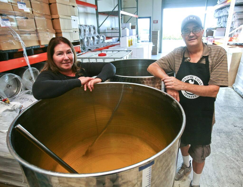 Jill and Doug Olson at their Sonoma Coast Spirits craft distillery in Petaluma on Monday, September 7, 2015. (SCOTT MANCHESTER/ARGUS-COURIER STAFF)