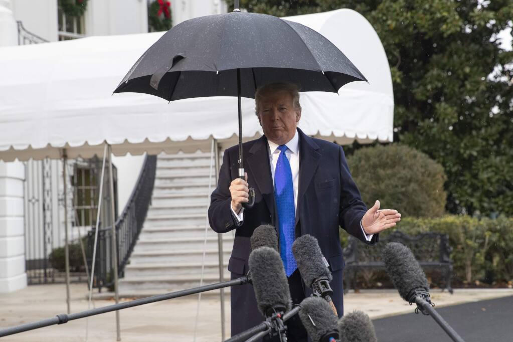 President Donald Trump speaks with reporters on the South Lawn of the White House before departing, Monday, Dec. 2, 2019, in Washington. (AP Photo/Alex Brandon)