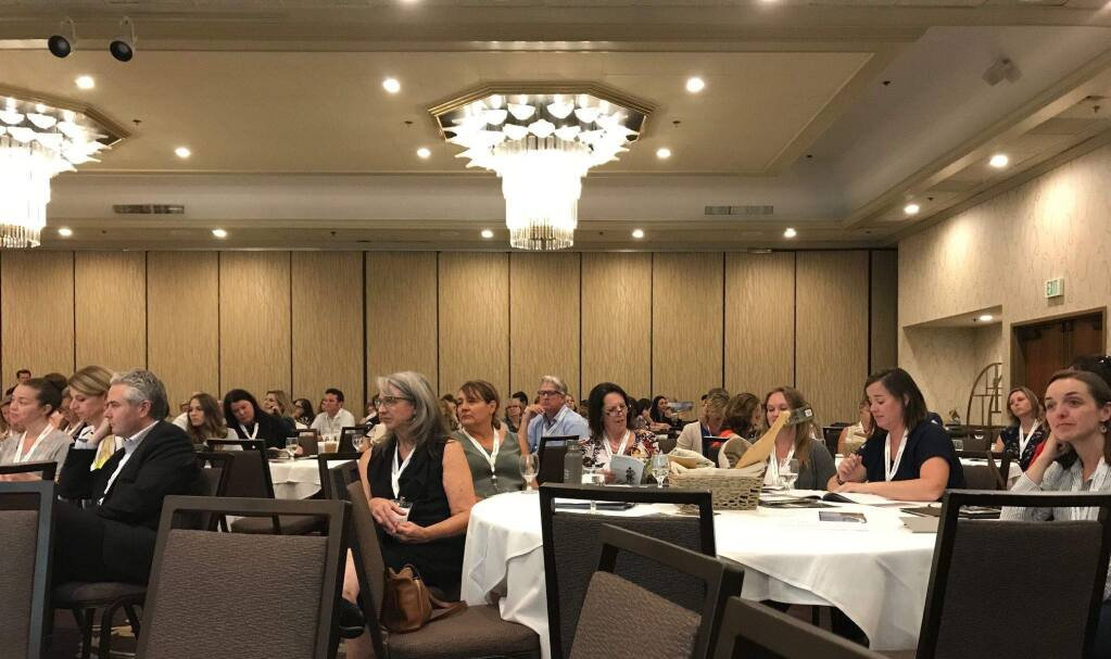 Attendees listen to presenters at Sonoma County Tourism's annual meeting, held Aug. 27 at DoubleTree Sonoma Wine Country Hotel in Rohnert Park. (Cheryl Sarfaty / North Bay Business Journal)