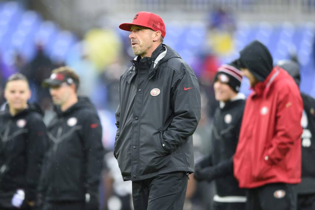 San Francisco 49ers head coach Kyle Shanahan walks on the field before the start of agame against the Baltimore Ravens, Sunday, Dec. 1, 2019, in Baltimore, Md. (AP Photo/Gail Burton)