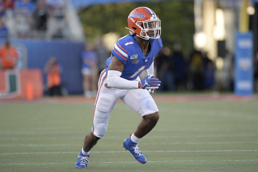 Florida defensive back CJ Hendersonfollows a play during the first half against Miami on Saturday, Aug. 24, 2019, in Orlando, Fla. (AP Photo/Phelan M. Ebenhack)