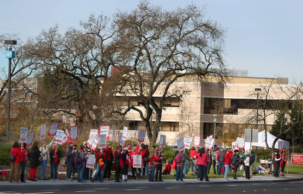 Mental health professionals and their supporters protest in front of Kaiser Permanente in Santa Rosa in this file photo taken Monday, January 12, 2015. The two sides agreed upon a tentative three-year contract late Sunday, Nov. 15, avoiding a strike that had been planned for Monday. (Christopher Chung/ The Press Democrat)