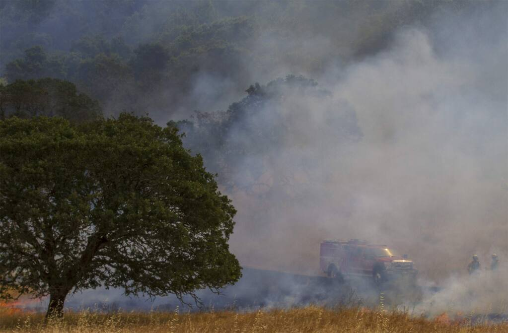 Firefighters used a drip torch to ignite 17.5 acres of grass at the Bouverie Preserve in Glen Ellen on Tuesday, May 30, 2017. More than two dozen firefighters from Cal Fire and Sonoma County fire departments participated in a controlled burn conducted by Audubon Canyon Ranch, in order to reduce build-up of non-native grasses and restore ecosystem health. (Photo by Robbi Pengelly/Index-Tribune)