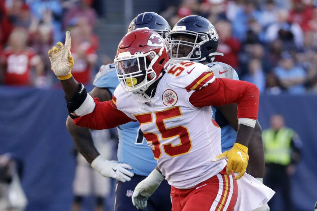 Kansas City Chiefs defensive end Frank Clark celebrates after a play against the Tennessee Titans in the second half Sunday, Nov. 10, 2019, in Nashville, Tenn. (AP Photo/James Kenney)