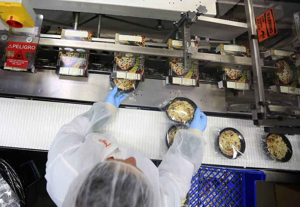 Meals are packaged for shipping at Amy's Kitchen in Santa Rosa in this 2013 file photo. (KENT PORTER / The Press Democrat)