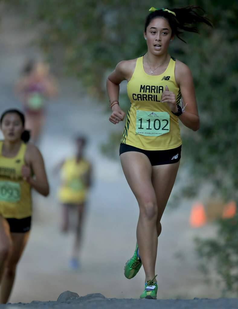 Nicole Morris of Maria Carrillo High School won the NBL-Oak girls cross country championship meet on Friday at Spring Lake in Santa Rosa. (Kent Porter / The Press Democrat)