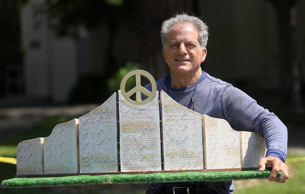 Michael Gillotti with a model of his peace sculpture that he will construct across from the Sebastopol Plaza, Tuesday August 25, 2015. (Kent Porter / Press Democrat)