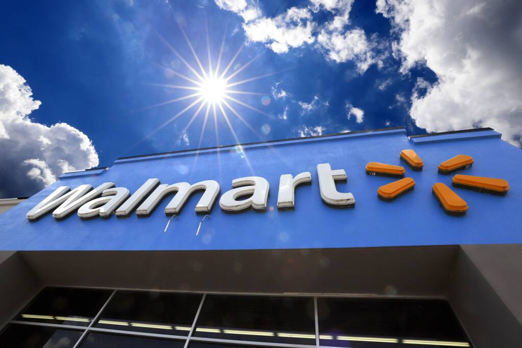 FILE - This June 25, 2019, file photo shows the entrance to a Walmart in Pittsburgh. (AP Photo/Gene J. Puskar, File)