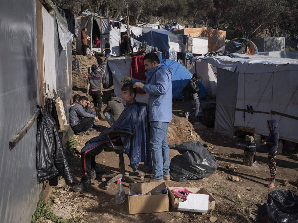 A sprawling tent city for migrants has spread into the olive groves and pine woods in Samos, Greece on Jan. 11, 2020. On Samos, the locals and asylum seekers bear the shared brunt of forces beyond their control, Greek government dysfunction, the cold shoulder of the European Union, the chaos in the Middle East and the geopolitical calculations of Turkey. (Laura Boushnak/The New York Times)