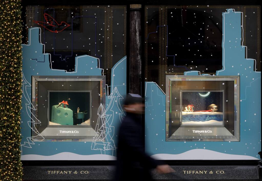 A pedestrian passes the shop window of Tiffany & Co. in London, Monday, Nov. 25, 2019. French luxury group LVMH has agreed to buy iconic New York jeweler Tiffany & Co. for $16.2 billion, adding a famed star to its portfolio that already boasts Louis Vuitton, Christian Dior and Bulgari. (AP Photo/Kirsty Wigglesworth)