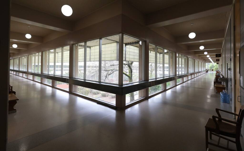 Hallways in the Sonoma County Superior Court are empty as the number of cases heard are reduced in response to the coronavirus, in Santa Rosa on Wednesday, March 18, 2020. (Christopher Chung/ The Press Democrat)