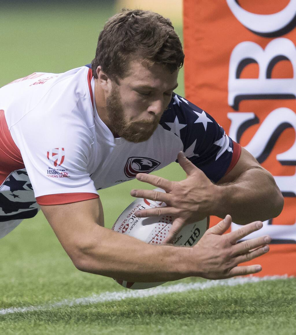 The United States' Stephen Tomasin, a Cardinal Newman grad, scores a try against Japan during a World Rugby Sevens Series match in Vancouver on Saturday, March 11, 2017. (Darryl Dyck/The Canadian Press via AP)