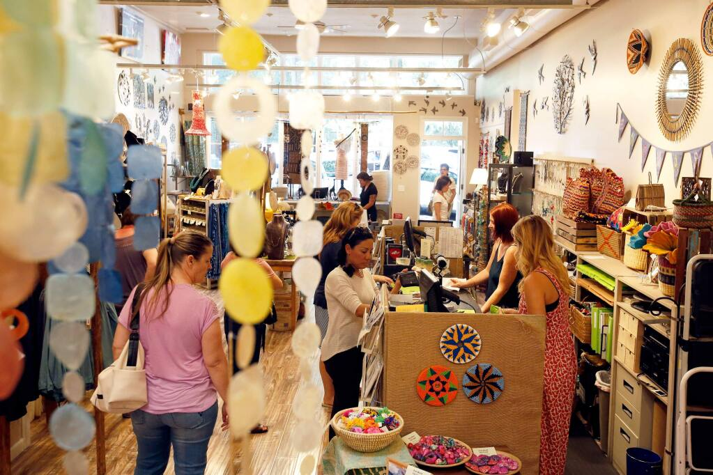 (FILE PHOTO) Customers browse and purchase products at One World Fair Trade in Healdsburg, California on Wednesday, July 26, 2017. (Alvin Jornada / The Press Democrat)