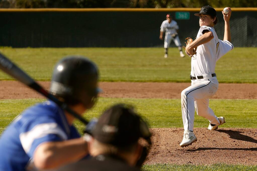 Maria Carrillo's Garrett Edy (21) pitches during during the first inning of a varsity baseball game between Analy and Maria Carrillo high schools in Santa Rosa, California, on Friday, March 15, 2019. (Alvin Jornada / The Press Democrat)