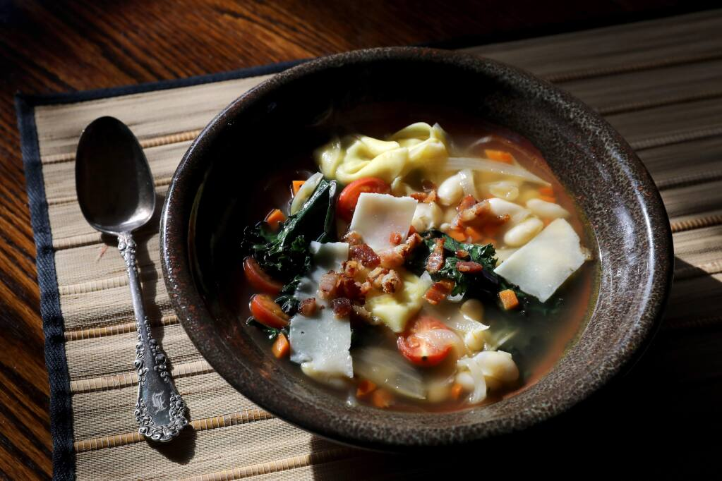 White bean and tortellini soup with kale prepared by John Ash at his home in Santa Rosa on Tuesday, Dec. 31, 2019. (BETH SCHLANKER/ The Press Democrat)