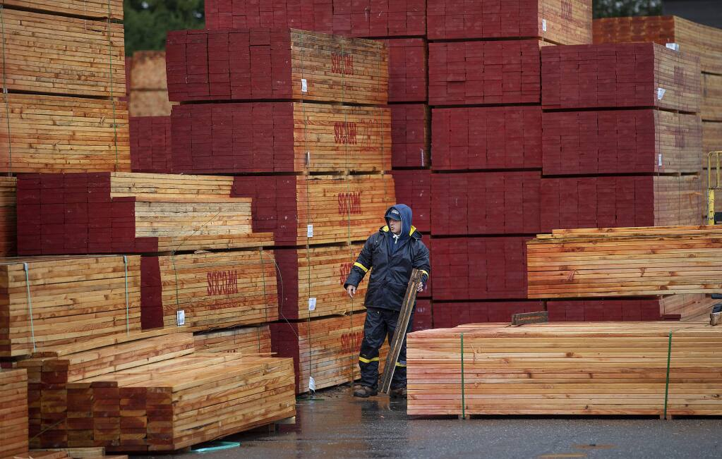 A Mead Clark Lumber Co. employee prepares a load of lumber heading for the rebuild in Coffey Park in Santa Rosa. (photo by John Burgess/The Press Democrat)