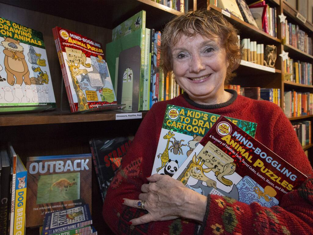 Vicki Whiting, known for her newspaper feature Kid Scoop, at Readers' Books on last year with two new children's books she produced. (Photo by Robbi Pengelly/Index-Tribune)