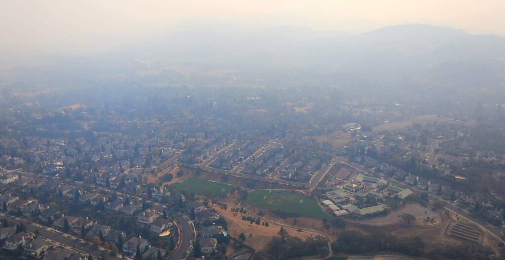 The Skyhawk community of Santa Rosa is enveloped in smoke from the raging Sonoma County fires, Wednesday, Oct. 11, 2017. (Kent Porter / Press Democrat) 2017