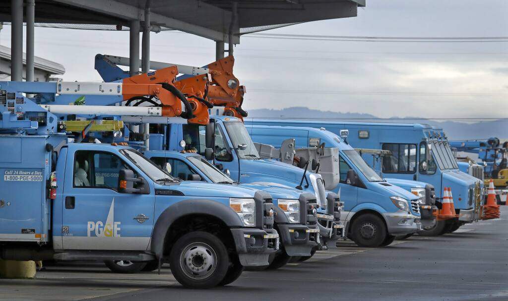 PG&E trucks staged to respond to power outages. (BEN MARGOT / Associated Press)