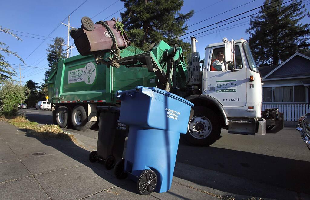 A garbage truck picks up yard waste in Santa Rosa. (PD FILE, 2011)
