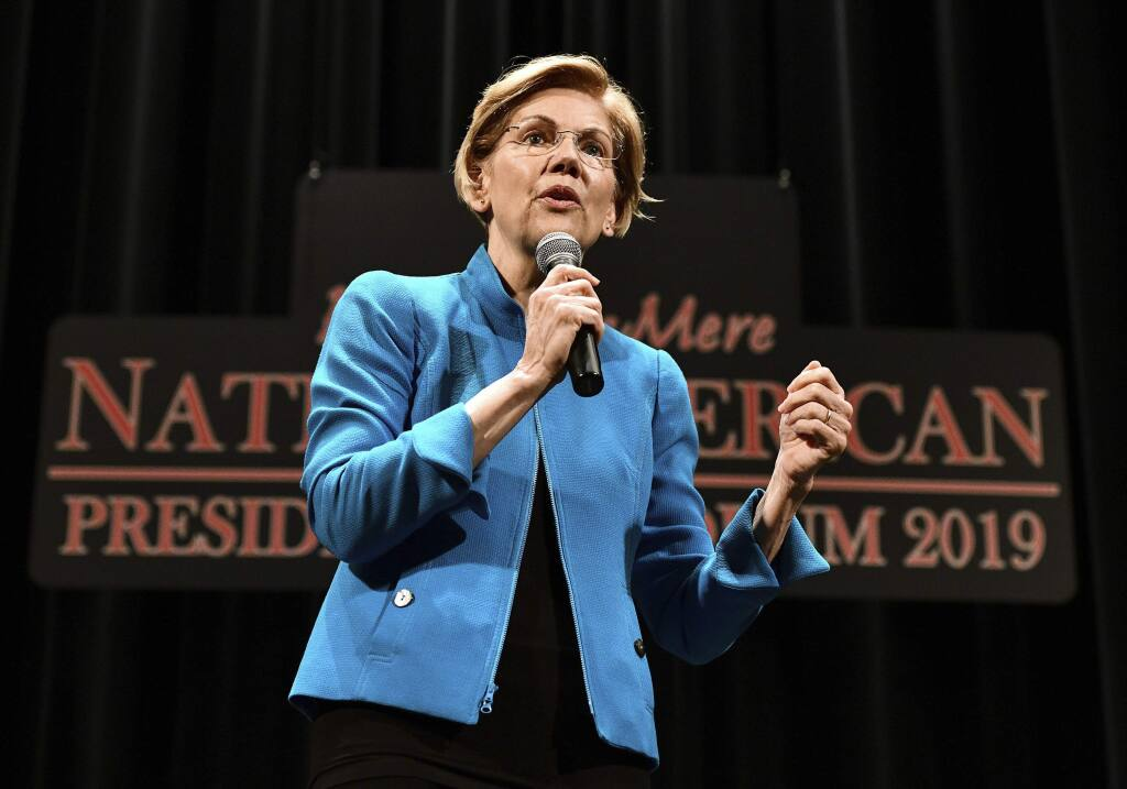 Elizabeth Warren, 2020 Democratic presidential hopeful, speaks during the first day of the Frank LaMere Native American Presidential Forum held Monday, Aug. 19, 2019 at the Orpheum Theatre in Sioux City, Iowa. (Tim Hynds/Sioux City Journal via AP)