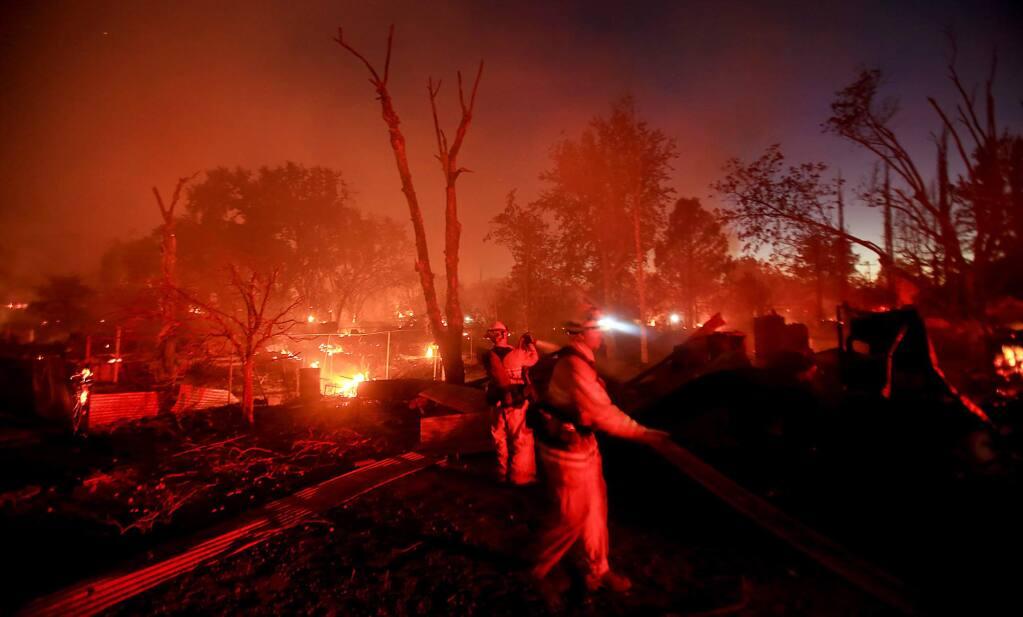 The Clayton fire razed the Winchester Street neighborhood of Lower Lake, Sunday August 14, 2016 in Lake County. (Kent Porter / Press Democrat) 2016