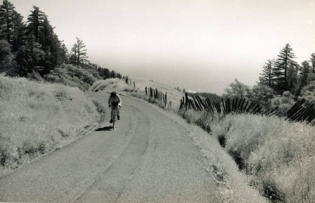 "A lone cyclist navigates Coleman Valley Road, which connects Occidental to the sea. The road, one of the proposed 'Heritage Roads"" in Sonoma County, is familiar to thousands of cyclists who have braved the long climb in Levi's GranFondo. (John LeBaron)"