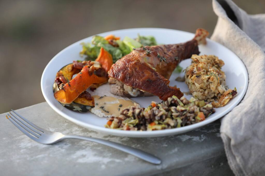 "Photos by BETH SCHLANKER / The Press DemocratA roasted turkey leg is surrounded by (clockwise) a wild mushroom and hazelnut ""stuffing,"" rice and fall vegetable ""stuffing,"" squash with a maple bacon glaze, and fall harvest salad from a Thanksgiving cooking workshop at Wind & Rye Kitchen in Penngrove."