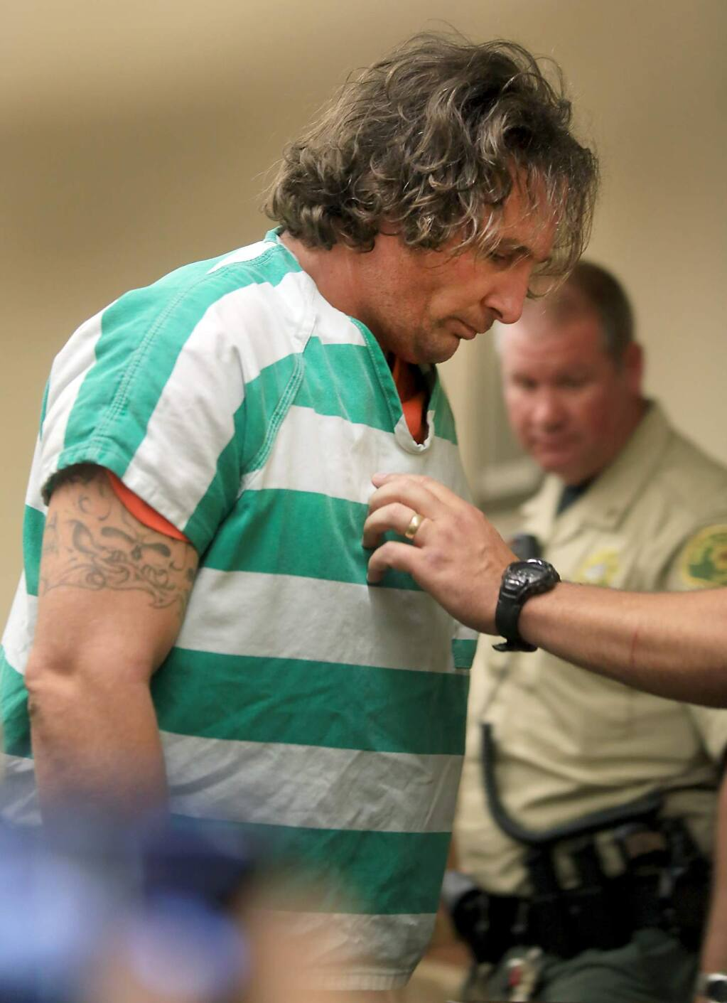 Damin Pashilk, 40, is taken from Lake County Superior Court, Wednesday August 17, 2016 after facing charges of arson in setting the Clayton fire in Lower Lake in Lake County. He did not enter a plea and the case was set over until September. Pashilk is resident of Lake County and faces numerous counts of arson dating back to 2015. (Kent Porter / Press Democrat) 2016