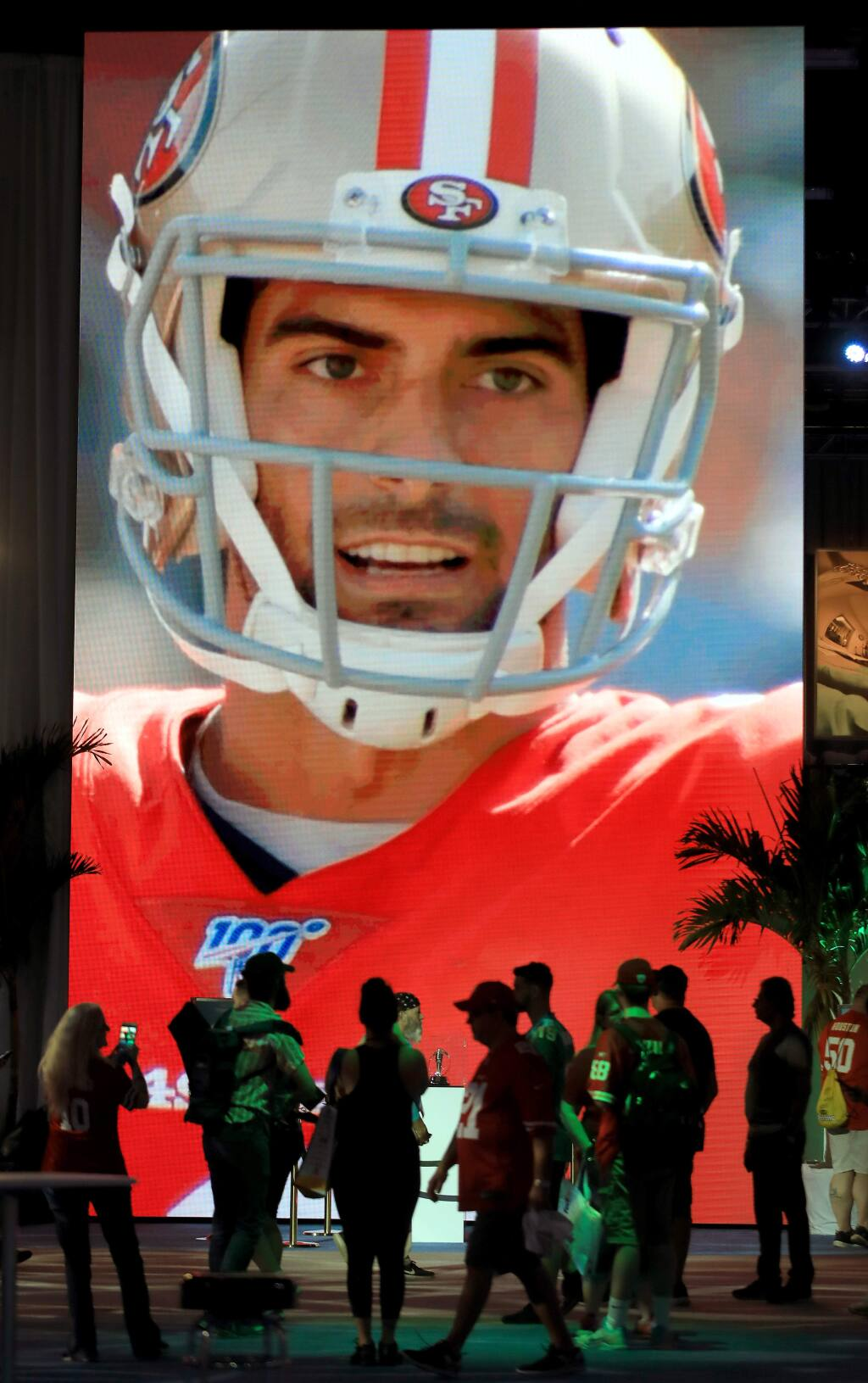 A larger than life video screen projects San Francisco quarterback Jimmy Garoppolo, Friday Jan. 31, 2020 in Miami Beach at the Super Bowl Experience. (Kent Porter / The Press Democrat) 2020
