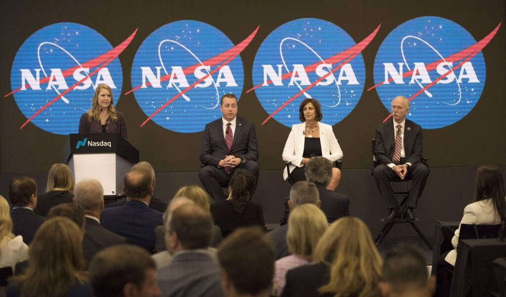 From right, Jeff Dewit, NASA's Chief Financial Officer; Robyn Gatens, NASA's Deputy Director of the International Space Station; Bill Gerstenmaier, NASA's associate administrator for the Human Exploration and Operations Mission, and Stephanie L. Schierholz Public Affairs Officer/Human Exploration and Operations, NASA, attend a news conference at Nasdaq in New York on Friday, June 7, 2019. NASA announced that the International Space Station will be open for private citizens, with the first visit expected to be as early 2020. (AP Photo/Marshall Ritzel)