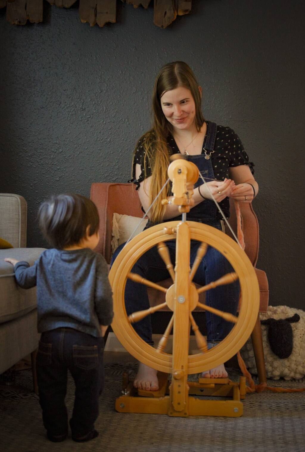 Petaluma, CA, USA. Tuesday, February 25, 2020._ Knitter Alisha Reyes opened Fiber Circle Studios in Cotati a few years ago. She teaches classes and creates indie dyed yarn in her studio where she is accompanied by her 11-month-old son, Dominic. (CRISSY PASCUAL/ARGUS-COURIER STAFF)