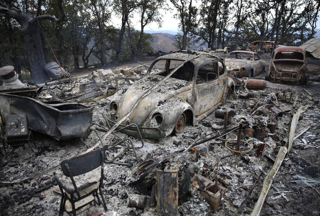 Burned vehicles on top of a ridge, north of Highway 20 near Clearlake Oaks, burned by the Rocky Fire, on Tuesday, August 4, 2015. (Christopher Chung/ The Press Democrat)