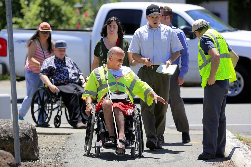 Ken Rossi, a blind disabled advocate, leads a group of disabled people and City of Santa Rosa traffic engineers on a 'walkabout' to identify difficult sidewalks and pathways near his home. (JOHN BURGESS/The Press Democrat)
