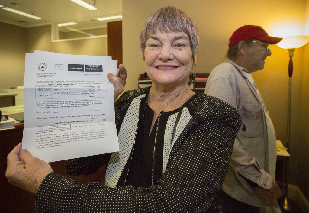Dispensary proprietor Jewel Mathieson picks up a business license from City Hall, which allows Sonoma Patient Group to deliver medical cannabis products into the City of Sonoma, on Dec. 20, 2018. (Photo by Robbi Pengelly/Index-Tribune)