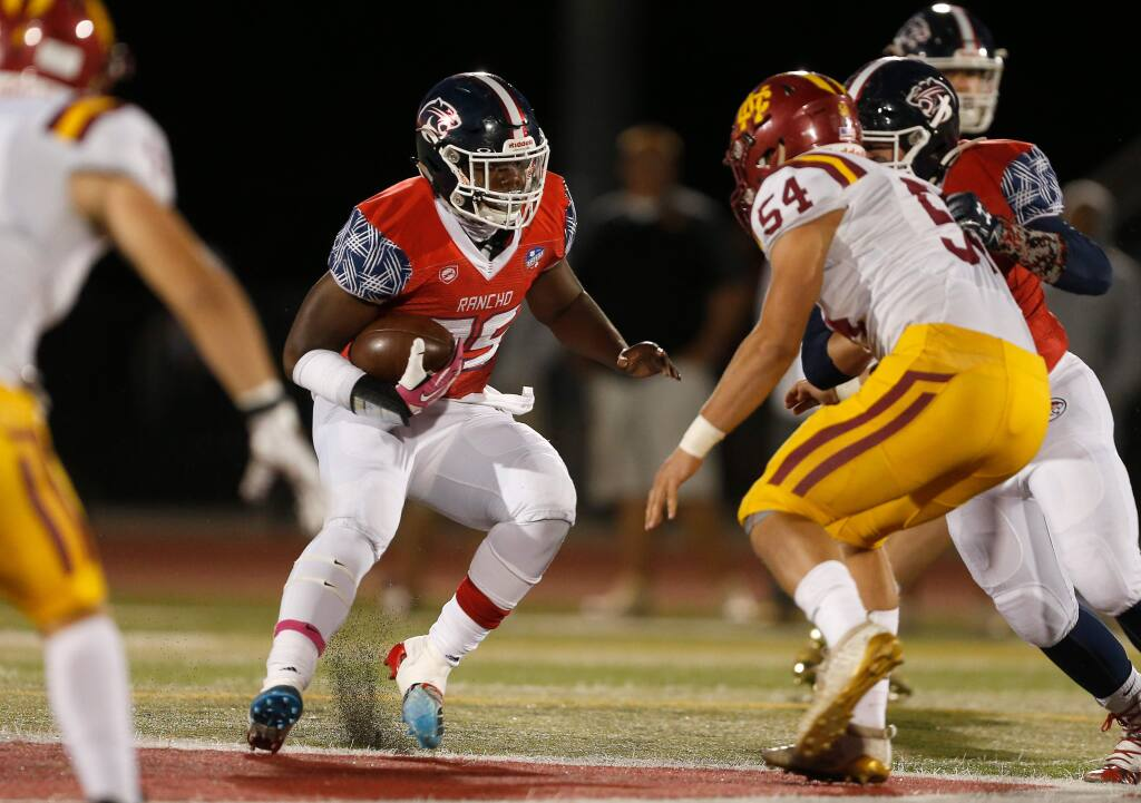 Rancho Cotate's Rasheed Rankin, left, tries to get around Cardinal Newman's Mitch Russell during the first half in Rohnert Park on Friday, Oct. 4, 2019. (Alvin Jornada / The Press Democrat)