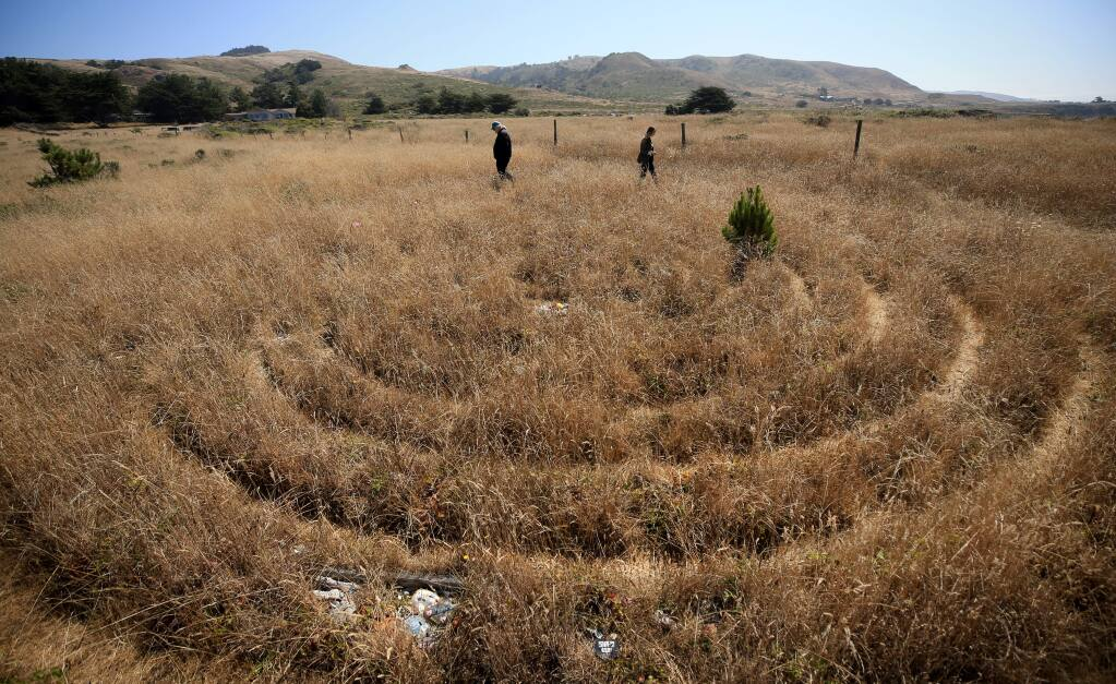 Retired California state park archaeologist Breck Parkman, left and Kaitlin Carlberg an anthropology student at U.C. Berkeley walk a labyrinth near Shell Beach on the Sonoma coast, Friday, August 30, 2019. (Kent Porter / The Press Democrat) 2019