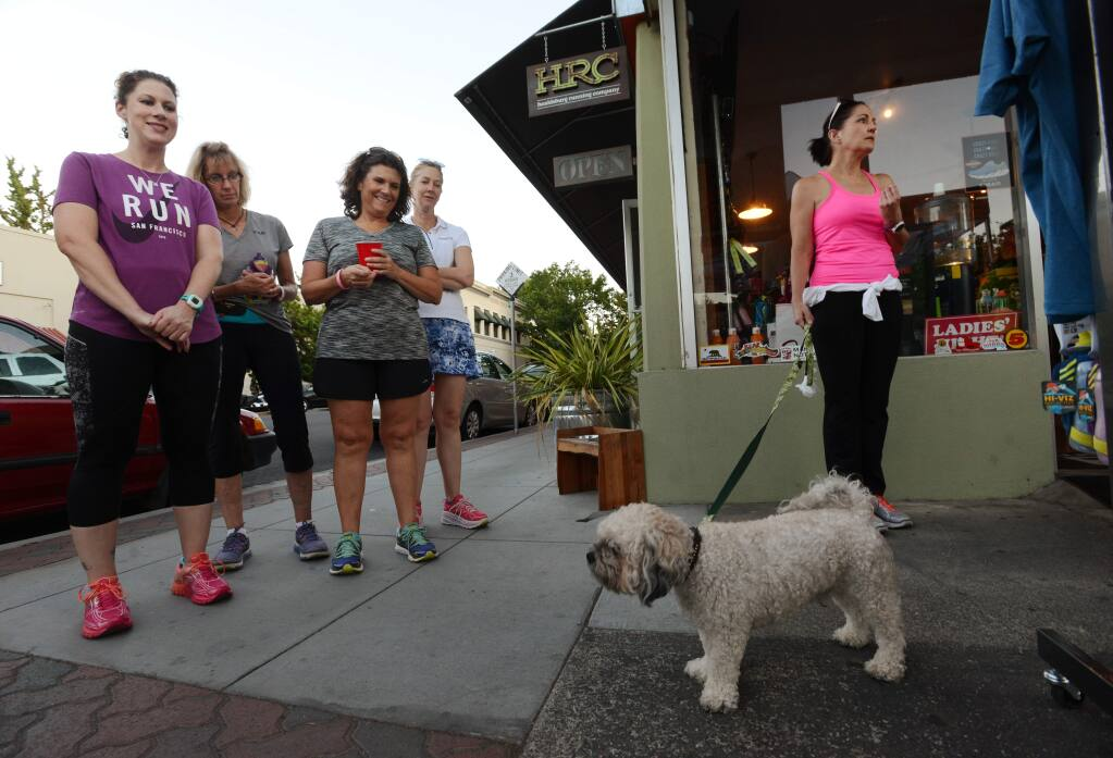 Runners at Tuesday's Ladies Night, from left, Shawna Goff, Stephanie Walter, Gina Nickel, Susan Lueker and Sandy Garvin with her dog Noodle, before they left on their evening jog from the Healdsburg Running Company in downtown Healdsburg. October 20, 2015. (Photo: Erik Castro/for The Press Democrat)