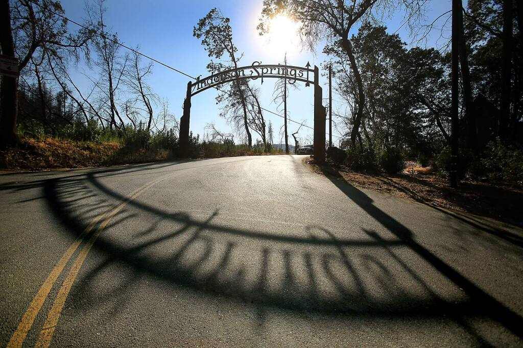 AFTER: Anderson Springs was all but wiped out by the Valley fire last September. Tall pines that once grew were burned, forcing crews to cut down most of them, Thursday Aug. 18, 2016, leaving a stark and changed landscape. (Kent Porter / The Press Democrat)