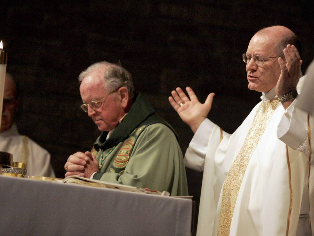 Rev. Robert Vasa, right, the Bishop of Santa Rosa, takes part in the eucharist with outgoing Bishop Daniel Walsh during a mass at St. Eugene's Cathedral in Santa Rosa, California on Sunday, March 6, 2011. (BETH SCHLANKER/ The Press Democrat)
